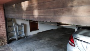 damaged-wooden-garage-door-panel